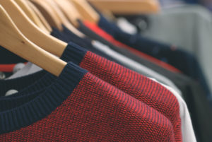 Close-up of hanging wool clothes at the store