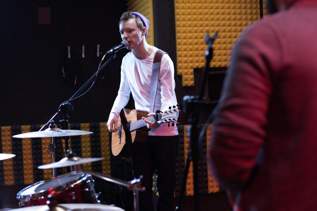 Guitarist Singing at Band Rehearsal